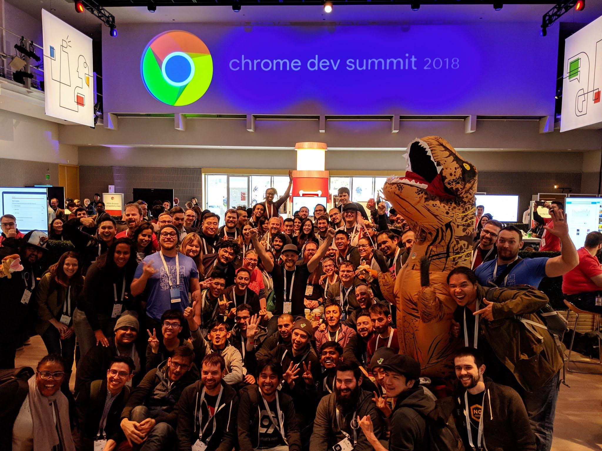 Group photo of attendees at Chrome Dev Summit with a person in a dinosaur costume